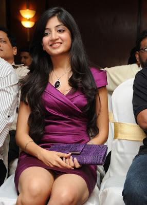 Poonam Kaur is in dark pink dress