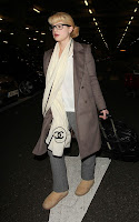 Kelly Osbourne Arrives at Heathrow Airport