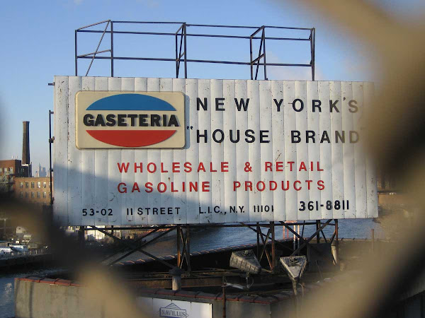 New York's House Brand - Next to the Pulaski Bridge in Long Island City, Queens, the sign's now covered with a cheap banner ad.