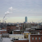 Queens Smoke 1 - Looking across Williamsburg from the bridge, power plant exhaust stands out from high clouds, and clear sky tinted turquoise like the Citibank tower in Queens, center-right.