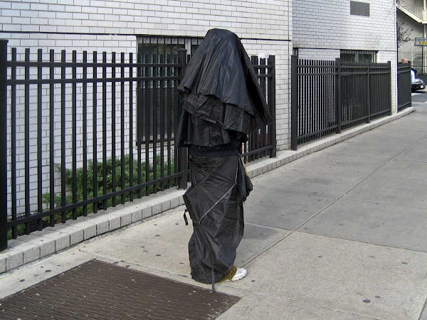 Mad Style 1 - Cloaked in umbrellas on 4th Ave. near 10th St.