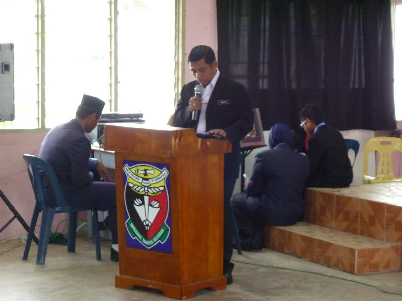 Perutusan dari Ketua Pengarah KPM dibacakan En. Roslan (GPK1).