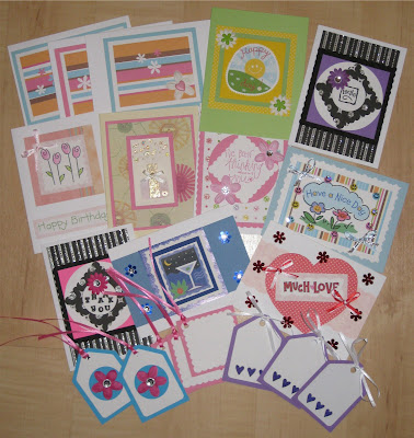 12 handmade greeting cards by me along with 8 handmade gift tags!