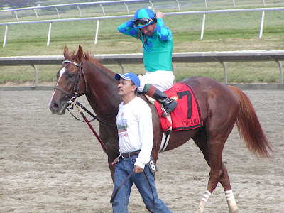 Kent Desormeaux and Adriano into the winner's circle