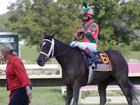 Proud Spell with a visibly disappointed Gabriel Saez after the Cotillion at Philadelphia Park, 2008