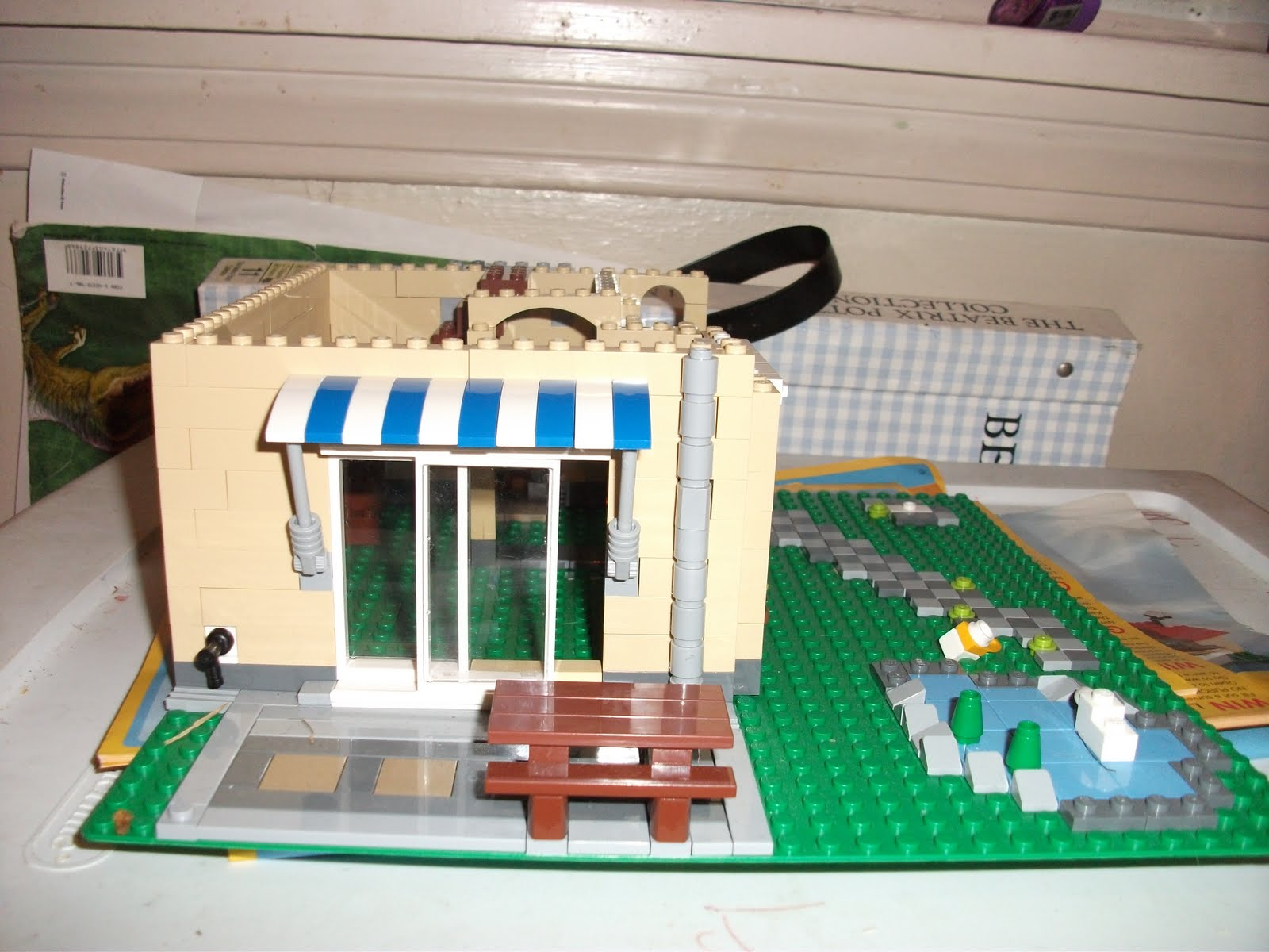 The blue and white awning hangs over sliding  glass  doors. Yes the doors can slide open! Thereu0027s a picnic table for the Lego ... & All You Need is Love: Lego Chronicles - Part 3