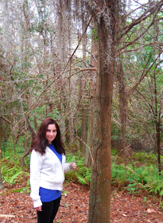 photo of fantasy fairy big eye artist julia finucane by a spanish moss tree in florida