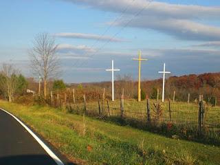 three crosses by road