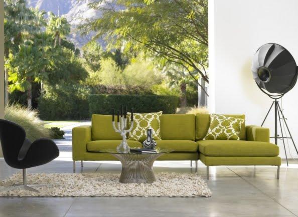 la naturaleza entra en el saln de la mano del sof charles un diseo de antonio citterio tapizado en color verde completan la composicin la butaca swan