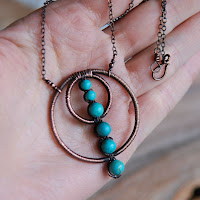 Copper Circles and Turquoise Wire Wrapped Necklace on Hand