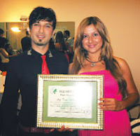 Aegean Forest Foundation's PR rep presented Tarkan with a Friend of Nature certificate