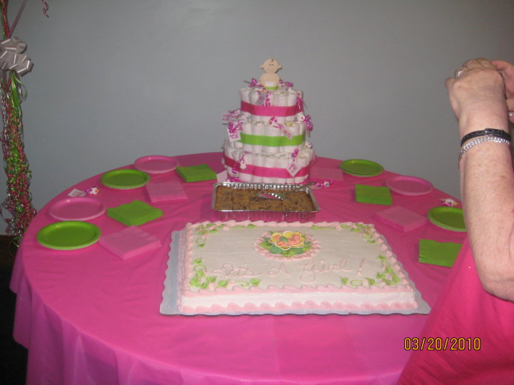 the cake table with the diaper cake made exclusively by manda