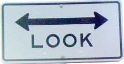 sign that says look, arrow sign