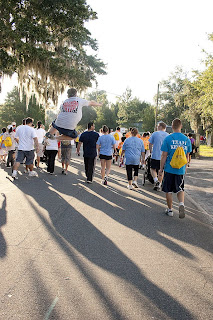 A crowd of walkers heads down Alden Rd. in Loch Haven park, for the first leg of the journey.