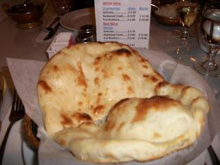 Click to enlarge -Naan, tandoori clay-oven baked bread.