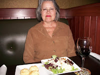 Click to enlarge - Salad from the salad bar and my glass of Pinot Noir