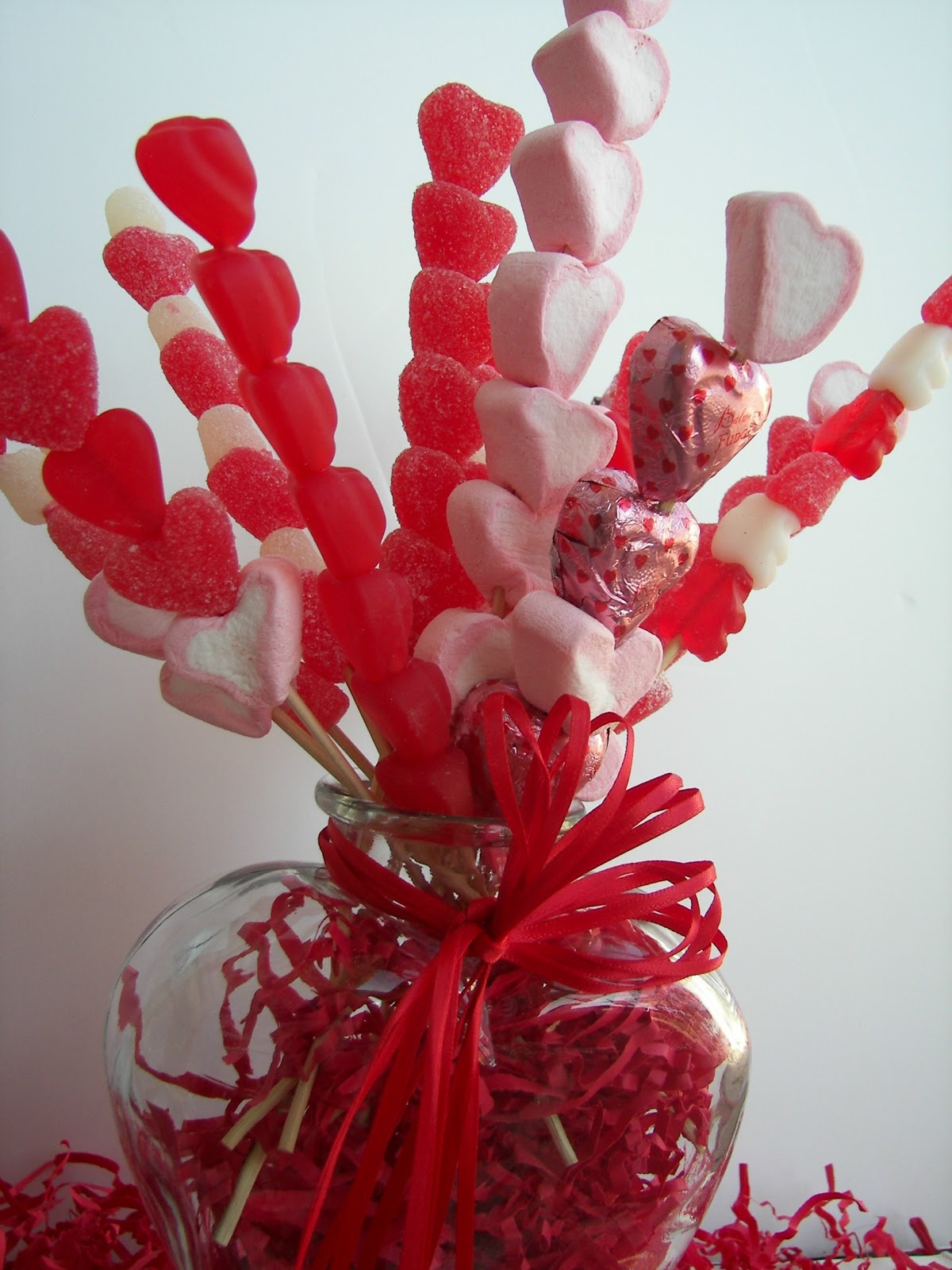 Love this Valentine's candy decor idea! The candy skewer bouquet is just so fun and different!