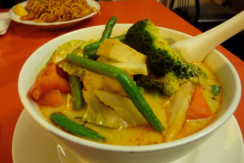 ... seasonal vegetables and tofu simmered in a mild spicy coconut soup