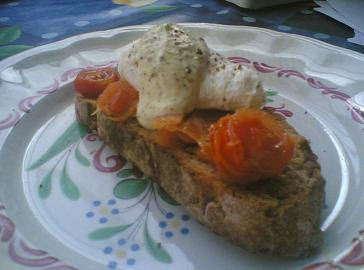 Poached egg, smoked salmon, mustard fromage frais and sautéed cherry tomatoes on toasted olive bread