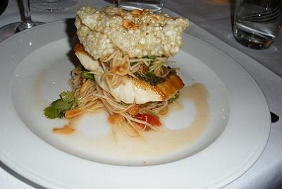 Wild sea bass on papaya and chilli salad with peanuts, shallots and shrimp crisp