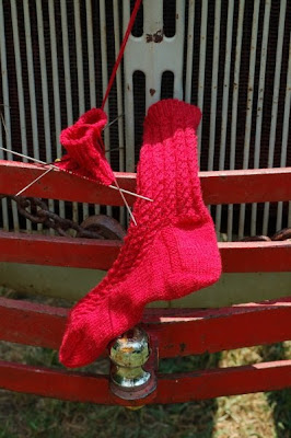 Red wool sock and a half, on Ford tractor