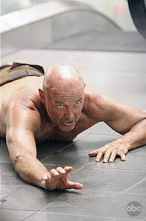 John Locke fell on ground crawling hurt Lost Island Terry O'Quinn