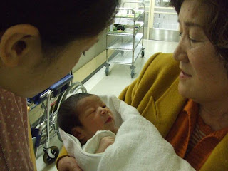 Grandma Kayoko and sleeping baby