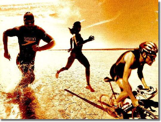 Athletes performing triathlon- swimming, running and biking.