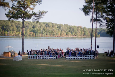 guests await by the lake for the bride to come down the aisle