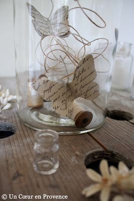 Butterfly made with old paper in a jar