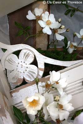Scene of delicate flowers in carved wood