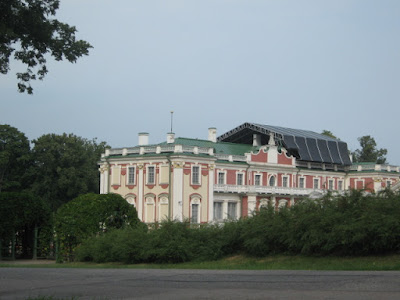 exterior of Kadriorg baroque palace surrounded by trees in Estonia