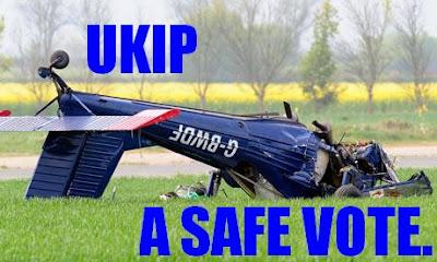 Former UKIP Leader's 'plane crashed and upside down on a field.  Caption: UKIP - a safe vote.