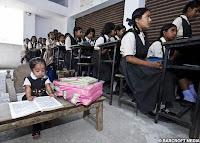 Jyoti at her special desk in school