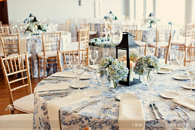 Toile tablecloths with hydrangea centerpieces cream napkins and natural
