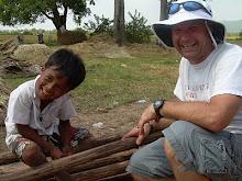 Cambodia 2009: Team Leader Tommy Marx and neighborhood boy.