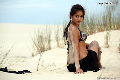 Neetu Chandra in a Bikini Top in a Desert image
