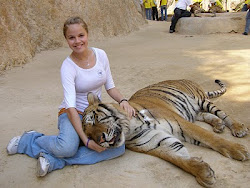 My second oldest daughter Amber with a tiger in Thailand