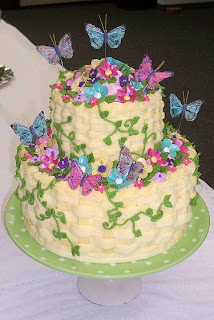 yellow basket cake with flowers and butterflies
