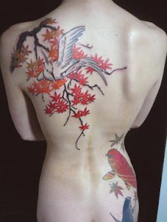 Label: bird japanese tattoo in located behind the back, Flower Behind The