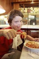 Darian chows down on his spaghetti