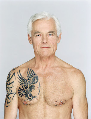 A grandfather showing his Celtic eagle tribal tattoo.