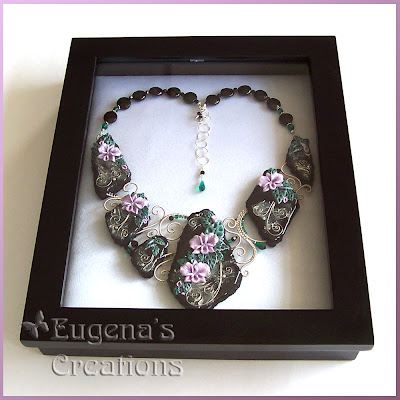 Eugena's polymer clay necklace in a new box