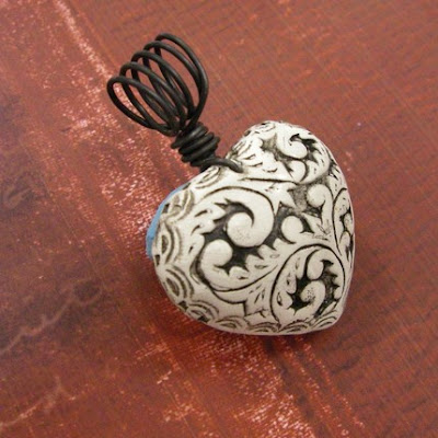 molded polymer clay pendant