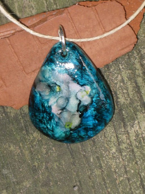 polymer clay, ink,  pendants