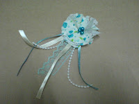 greenish blue flower brooch with ribbon and lace