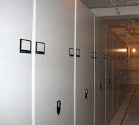 New compact storage systems are installed in the vaults.