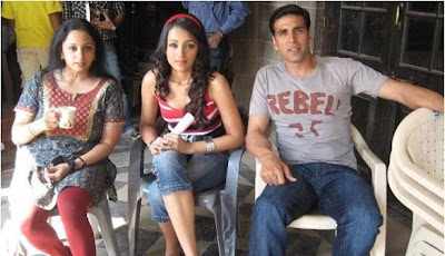 Trisha with akshay.JPG