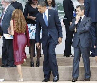 Obama looking at the girl