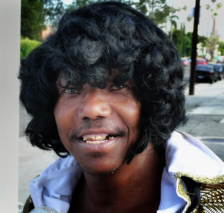 East Of West L.A.  Young Man With Wig And Broken Teeth 51f7da7af